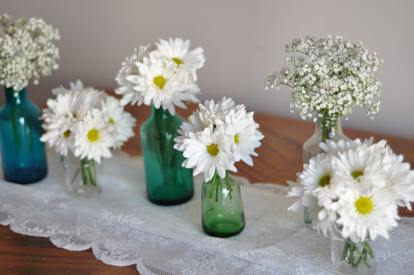 Mixed flowers in decorative glass vases