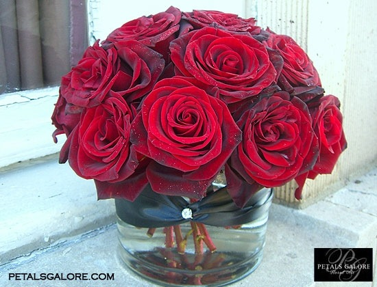 Centerpieces like that but different shades of red freedom black magic